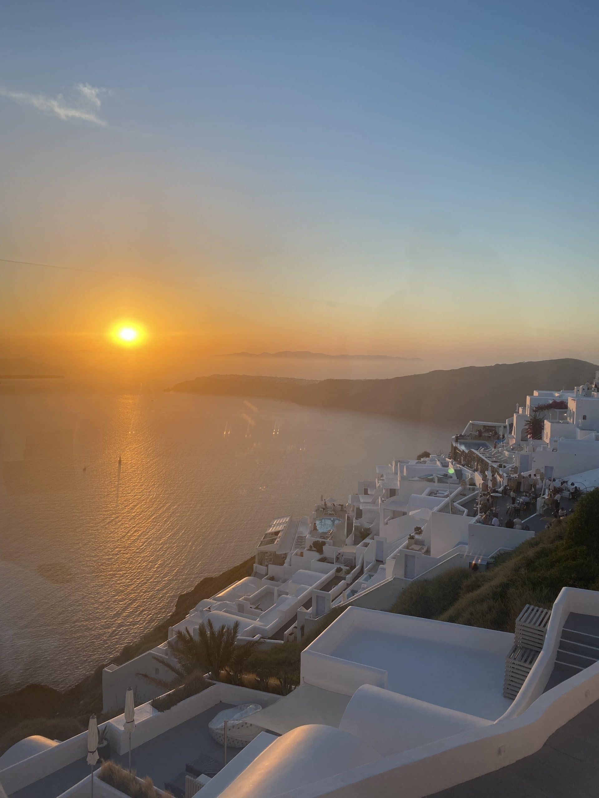 view from athenian house at sunset santorini greece